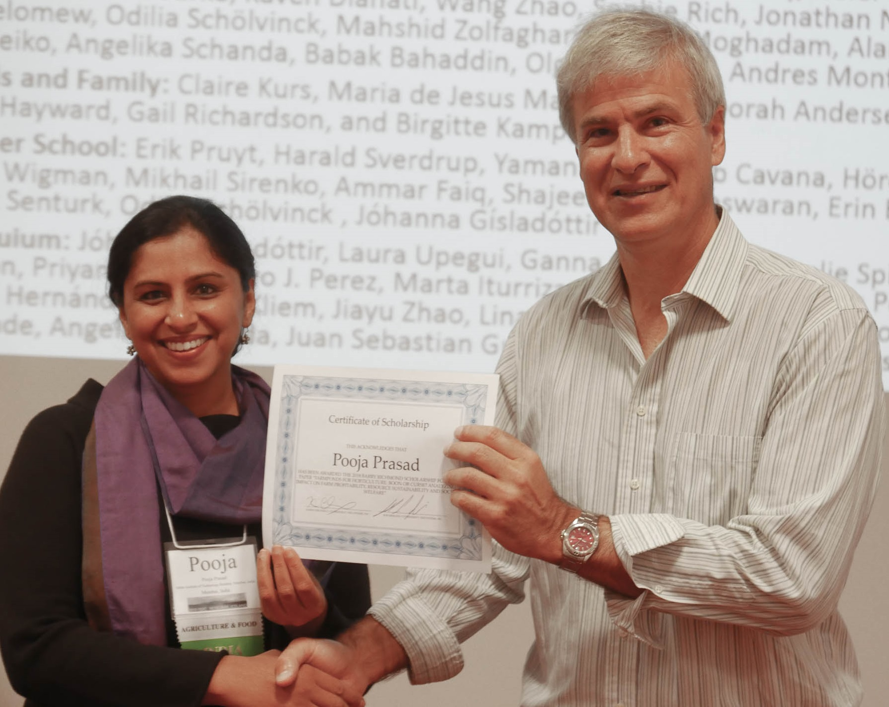 Pooja Prasad accepts Scholarship Award from Karim Chichakly